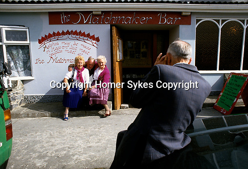Lisdoonvarna County Clare Eire 1990s. Annual month long matchmaking festival.  A photographic souvenir of a lovely time taken outside of Matchmakers bar.  Southern Ireland