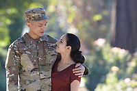 Male soldier and wife, model-released, DoD-compliant for advertising, couple portrait, Asian and Hispanic <br /> <br /> Model-released stock photograph, DoD-compliant for advertising and promotion.  Reproduction requires paid license.