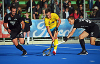 Dylan Thomas (right) tackles Australia's Lachlan Sharp as Dane Lett (left) closes in during the Sentinel Homes Trans Tasman Series hockey match between the New Zealand Black Sticks Men and the Australian Kookaburras at Massey University Hockey Turf in Palmerston North, New Zealand on Sunday, 30 May 2021. Photo: Dave Lintott / lintottphoto.co.nz