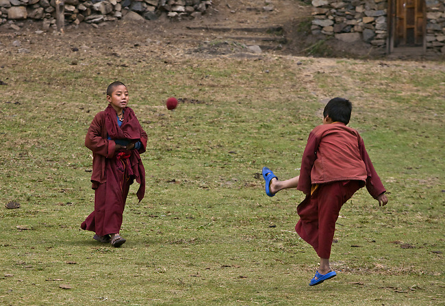 Young MONKS play soccer at a remote TIBETAN BUDDHIST MONASTERY - NEPAL HIMALAYA