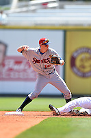 Tennessee Smokies second baseman Wes Darvill (16) attempts to turn a double play during a game against the Birmingham Barons on April 21, 2014 at Regions Field in Birmingham, Alabama.  Tennessee defeated Birmingham 10-5.  (Mike Janes/Four Seam Images)
