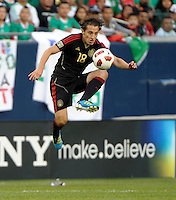 Mexico's Andres Guardado leaps high in the air to control a long pass.  Mexico defeated Costa Rica 4-1 at the 2011 CONCACAF Gold Cup at Soldier Field in Chicago, IL on June 12, 2011.