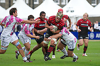 20120823 Copyright onEdition 2012©.Free for editorial use image, please credit: onEdition..Kelly Brown of Saracens is tackled as Mako Vunipola, Mouritz Botha and Petrus du Plessis of Saracens support at The Honourable Artillery Company, London in the pre-season friendly between Saracens and Stade Francais Paris...For press contacts contact: Sam Feasey at brandRapport on M: +44 (0)7717 757114 E: SFeasey@brand-rapport.com..If you require a higher resolution image or you have any other onEdition photographic enquiries, please contact onEdition on 0845 900 2 900 or email info@onEdition.com.This image is copyright the onEdition 2012©..This image has been supplied by onEdition and must be credited onEdition. The author is asserting his full Moral rights in relation to the publication of this image. Rights for onward transmission of any image or file is not granted or implied. Changing or deleting Copyright information is illegal as specified in the Copyright, Design and Patents Act 1988. If you are in any way unsure of your right to publish this image please contact onEdition on 0845 900 2 900 or email info@onEdition.com