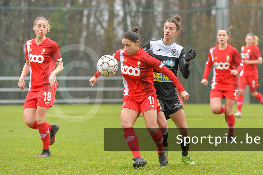 Lola Wajnblum (11) of Standard and Justine Blave (22) of Eendracht Aalst pictured during a female soccer game between Standard Femina de Liege and Eendracht Aalst on the 12 th matchday of the 2020 - 2021 season of Belgian Scooore Womens Super League , saturday 30 th of January 2021 in Angleur , Belgium . PHOTO SPORTPIX.BE | SPP | STIJN AUDOOREN