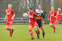 Lola Wajnblum (11) of Standard and Justine Blave (22) of Eendracht Aalst pictured during a female soccer game between Standard Femina de Liege and Eendracht Aalst on the 12 th matchday of the 2020 - 2021 season of Belgian Scooore Womens Super League , saturday 30 th of January 2021 in Angleur , Belgium . PHOTO SPORTPIX.BE   SPP   STIJN AUDOOREN