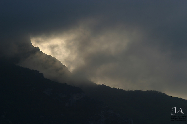 Positano hills at dawn with an angry sky