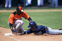 Tampa Bay Rays Angel Perez (87) dives back to first as the ball gets away from first baseman Yaisel Mederos (51) during an instructional league game against the Baltimore Orioles on September 25, 2015 at Ed Smith Stadium in Sarasota, Florida.  (Mike Janes/Four Seam Images)
