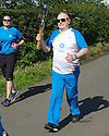 Hollywood actor and current Rector of The University of Dundee, Brian Cox, makes his way through Roslin to Rosslyn Chapel with the Queen's Baton.