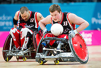 18 APR 2012 - LONDON, GBR - Canadian Zak Madell (CAN) (Class 3.5) (right) races for the goal line supported by team mate Jared Funk (CAN) (Class 0.5) (left) during their London International Invitational Wheelchair Rugby Tournament match against Great Britain at the Olympic Park Basketball Arena in Stratford, London, Great Britain (PHOTO (C) 2012 NIGEL FARROW)