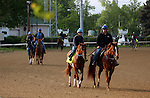 LOUISVILLE, KY - APRIL 28: Creator (grey horse, far left, ridden by Abel Flores) is ponied by trainer Steven M. Asmussen, while Gun Runner (chestnut horse in foreground on right) is ponied by assistant trainer Scott Blasi, on their way to school in the starting gate at Churchill Downs, Louisville, KY.Both are preparing for the Kentucky Derby. (Photo by Mary M. Meek/Eclipse Sportswire/Getty Images)