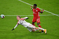 3rd January 2021, Allianz Arean, Munich Germany; Bundesliga Football, Bayern Munich versus FSV Mainz; David ALABA (Bayern) challenges Jonathan BURKHARDT (FSV Mainz 05)