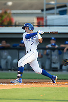 Austin Bailey (7) of the Burlington Royals follows through on his swing against the Bluefield Blue Jays at Burlington Athletic Park on June 29, 2015 in Burlington, North Carolina.  The Royals defeated the Blue Jays 4-1. (Brian Westerholt/Four Seam Images)