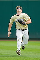 Wake Forest Demon Deacons right fielder Jack Carey #20 tracks a fly ball against the North Carolina State Wolfpack at Doak Field at Dail Park on March 17, 2012 in Raleigh, North Carolina.  The Wolfpack defeated the Demon Deacons 6-2.  (Brian Westerholt/Four Seam Images)