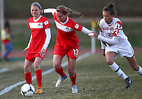 COLLEGE PARK, MARYLAND - April 03, 2013:  Julia Roberts (13) of The Washington Spirit keeps the ball from Alexis Prior-Brown (23) of the University of Maryland women's soccer team in a NWSL (National Women's Soccer League) pre season exhibition game at Ludwig Field in College Park Maryland on April 03. Maryland won 2-0.