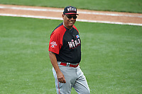 World Team manager Tony Perez (24) walks to the dugout after a mound meeting during the MLB All-Star Futures Game on July 12, 2015 at Great American Ball Park in Cincinnati, Ohio.  (Mike Janes/Four Seam Images)