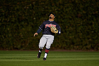 Cleveland Indians center fielder Rajai Davis (20) settles under a fly ball in the fifth inning during Game 5 of the Major League Baseball World Series against the Chicago Cubs on October 30, 2016 at Wrigley Field in Chicago, Illinois.  (Mike Janes/Four Seam Images)