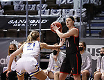 SIOUX FALLS, SD - MARCH 6: Claire Killian #11 of the Omaha Mavericks looks for a teammate past Tylee Irwin #21 of the South Dakota State Jackrabbits during the Summit League Basketball Tournament at the Sanford Pentagon in Sioux Falls, SD. (Photo by Richard Carlson/Inertia)