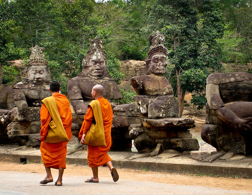 The saffron robes of these monks; ancient stone statues lining the entrance to the temple:  priceless.