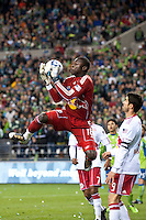 New York goalkeeper  Bouna Coundoul (18) goes up for a save as the Seattle Sounders lost to the New York Red Bulls, 1-0, in an MLS match on Saturday, April 3, 2010 at Qwest Field in Seattle, WA.