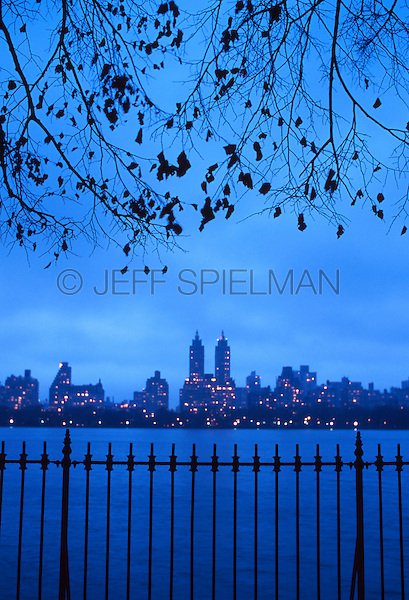 AVAILABLE FROM GETTY IMAGES FOR COMMERCIAL AND EDITORIAL LICENSING.    Please go to www.gettyimages.com and search for image # a0142-000205.<br /> <br /> Upper West Side Skyline at Dusk Viewed from the Central Park Reservoir, Central Park, New York City, New York State, USA