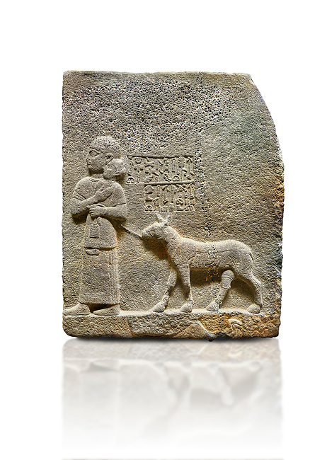"""Hittite monumental relief sculpted orthostat stone panel of Royal Buttress. Basalt, Karkamıs, (Kargamıs), Carchemish (Karkemish), 900-700 B.C. Anatolian Civilisations Museum, Ankara, Turkey<br /> <br /> The queen carries her youngest son. The hieroglyphs located above read; """"and this is Tuwarsais; the prince desired by the ruler, whose exclusiveness has been exposed"""". While the queen carries her son in her lap, she holds the rope of the colt coming behind with her other hand. The muscles of the colt are schematic. <br /> <br /> Against a white background."""