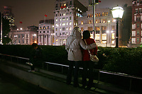 CHINA. Shanghai. Tourists along the Bund. Shanghai is a sprawling metropolis or 15 million people situated in south-east China. It is regarded as the country's showcase in development and modernity in modern China. This rapid development and modernization, never seen before on such a scale has however spawned countless environmental and social problems. 2008