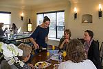Reno Magazine editor Laura Longero, center, serves guests during Reno Magazine's Home Decor Workshop at Aspen Leaf Interiors Studio in Reno on Saturday, March 24, 2018.