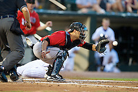 Indianapolis Indians catcher Tony Sanchez #19 gets a throw as Ronnier Mustelier #10 slides home safely during a game against the Empire State Yankees at Frontier Field on August 4, 2012 in Rochester, New York.  Empire State defeated Indianapolis 9-8 in ten innings.  (Mike Janes/Four Seam Images)