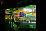 BROOKLYN, NY — SEPTEMBER 29, 2020:  The Presidential Debate between President Donald Trump and former Vice President Joe Biden is broadcast on a TV at Banana Boat Restaurant on September 29, 2020 in Brooklyn, NY.  Photograph by Michael Nagle