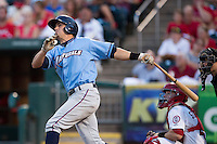 Brett Eibner (24) of the Northwest Arkansas Naturals follows through his swing after hitting a home run during a game against the Springfield Cardinals at Hammons Field on August 23, 2013 in Springfield, Missouri. (David Welker/Four Seam Images)