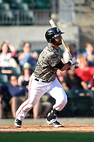Arkansas Travelers third baseman Brian Hernandez (12) at bat during a game against the San Antonio Missions on May 25, 2014 at Dickey-Stephens Park in Little Rock, Arkansas.  Arkansas defeated San Antonio 3-1.  (Mike Janes/Four Seam Images)