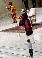 A child plays and gestures as Pope Francis attends his weekly general audiencein the Paul VI hall at the Vatican, January 22, 2020.<br /> <br /> UPDATE IMAGES PRESS/Riccardo De Luca<br /> <br /> STRICTLY ONLY FOR EDITORIAL USE A child walks on the floor as Pope Francis attends his weekly general audience in the Paul VI hall at the Vatican, January 22, 2020.<br />