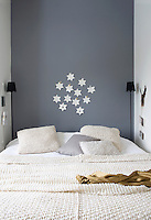 The stars in the bedroom alcove are paper cut-outs, mounted on a wall painted in a chalky 'Down Pipe' by Farrow & Ball