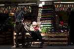 A woman and child examine the wares at the floating flower market in Amsterdam.