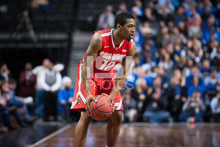BROOKLYN, NY - Saturday December 19, 2015: A.J. Harris (#12) of Ohio State plans his next move against Kentucky as the two teams square off in the CBS Classic at Barclays Center in Brooklyn, NY.