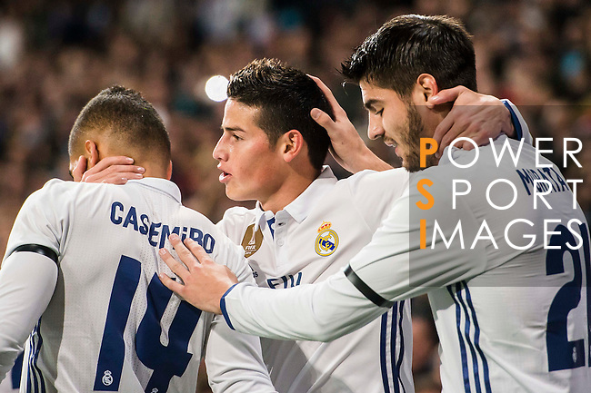 James Rodriguez of Real Madrid celebrates with teammates during their Copa del Rey Round of 16 match between Real Madrid and Sevilla FC at the Santiago Bernabeu Stadium on 04 January 2017 in Madrid, Spain. Photo by Diego Gonzalez Souto / Power Sport Images