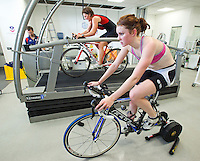 22 MAR 2012 - LOUGHBOROUGH, GBR - British triathletes Lucy Hall (right) and Abbie Thorrington (centre) train in the Performance Lab at Loughborough University watched by British Triathlon's Performance Coach Mark Pearce (PHOTO (C) 2012 NIGEL FARROW)