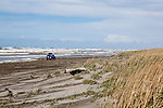 """Driving on the beach is legal at Long Beach, WA, """"The Worlds Longest Beach"""", however this vehicle was forced high up the beach by storm driven surf.  Loomis Lake State Park area of the Long Beach Penninsula. Olympic Peninsula"""