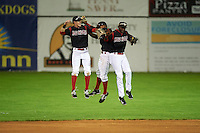Batavia Muckdogs outfielders Brandon Rawe, Stone Garrett and Galvi Moscat jump in celebration after a game against the Auburn Doubledays July 8, 2015 at Dwyer Stadium in Batavia, New York.  Batavia defeated Auburn 4-1.  (Mike Janes/Four Seam Images)