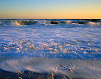 Seascape of ocean waves in early morning light. Wantagh, New York.