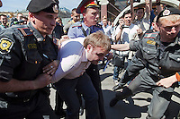 Moscow, Russia, 28/05/2011..Police detain a demonstrator at an attempted gay pride parade in central Moscow. Several dozen people were arrested during clashes as Russian nationalists attacked gay rights activists during their sixth attempt to hold a gay pride parade in the Russian capital.