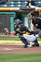 Luis Martinez (20) of the Salt Lake Bees behind the plate with home plate umpire Roberto Ortiz during the game against the Sacramento River Cats at Smith's Ballpark on April 5, 2014 in Salt Lake City, Utah.  (Stephen Smith/Four Seam Images)