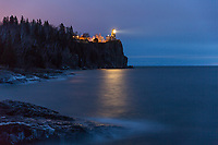"""""""Beacon of Remembrance"""" ~ Split Rock Lighthouse shines its light out over Lake Superior on the 42nd anniversary of the sinking of the SS Edmund Fitzgerald. The annual remembrance ceremony is a fitting tribute to the crew of the Fitzgerald and other mariners lost on the Great Lakes. A solemn mood falls over the shore as onlookers witness the beacon reach across Lake Superior with each rotation."""
