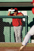 Williamsport Crosscutters pitching coach Hector Berrios (21) in the dugout during a game against the Batavia Muckdogs on June 21, 2018 at Dwyer Stadium in Batavia, New York.  Batavia defeated Williamsport 6-5.  (Mike Janes/Four Seam Images)