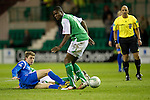 Hibs v St Johnstone....27.11.10  .Murray Davidson tackles Francis Dickoh.Picture by Graeme Hart..Copyright Perthshire Picture Agency.Tel: 01738 623350  Mobile: 07990 594431