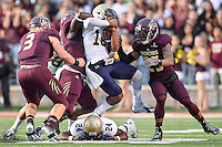 Texas State linebacker Trey McGowen (52) tackles Navy quarterback Tago Smith (18) during first half of NCAA Football game, Saturday, September 13, 2014 in San Marcos, Tex. Navy defeated Texas State 35-21.(Mo Khursheed/TFV Media via AP Images)