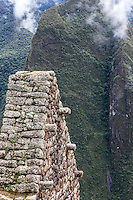 Peru, Machu Picchu.  Roofline of a House, Andes Mountains in the Background.