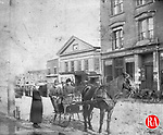 Frederick Stone negative. Front of 65  Bank Street, John Mullings & Co. store in background.<br /> March 3,1888.