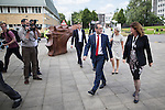 © Joel Goodman - 07973 332324 . SUBMIT PHOTO . MANCHESTER EVENING NEWS ONLY - NO SYNDICATION PERMITTED . 15/08/2016 . Salford , UK . Labour leadership candidate OWEN SMITH (3rd from right) arrives with campaign director KATE SMITH (2nd from right) and is greeted by University Vice Chancellor HELEN MARSHALL (1st right) to deliver a speech on the National Health Service , at the Mary Seacole Building at Salford University . Photo credit : Joel Goodman
