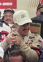 Davey Allison 1st place winner victory lane champagne celebrates Pepsi 400 at Daytona International Speedway in Daytona beach, FL on July 1, 1989. (Photo by Brian Cleary/www.bcpix.com)